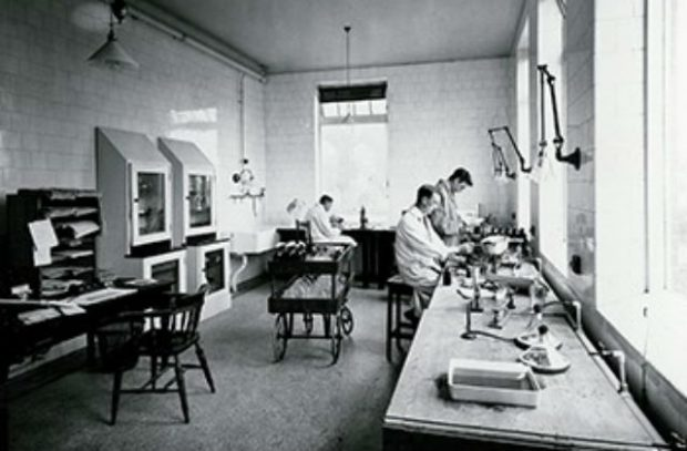 Photo of scientists working in a Weybridge lab between the wars