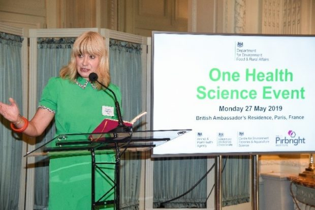 The CVO standing in front of a presentation of One Health