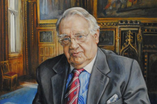 A portrait of Lord Soulsby of him sitting in an ornate room with paintings