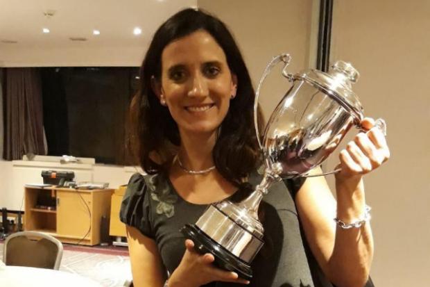 Eva holding a trophy
