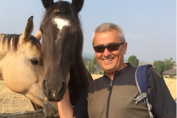 Milorad standing next to two horses