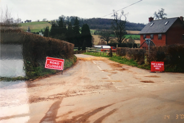 A closed road with an FMD sign