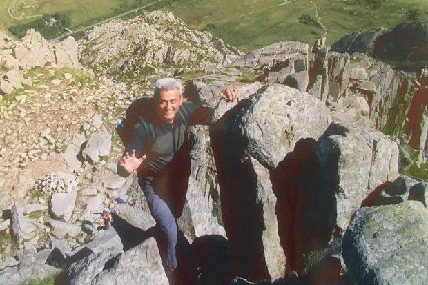 Milorad climbing on some rocks